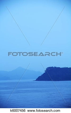 Stock Images of blue sky, sea, hill and mist with vintage.