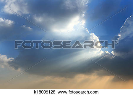 Pictures of Sun break through the big white cloud and blue sky.