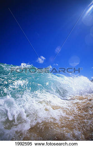 Stock Image of Turbulent Shoreline Break Water, Sun Rays In Clear.