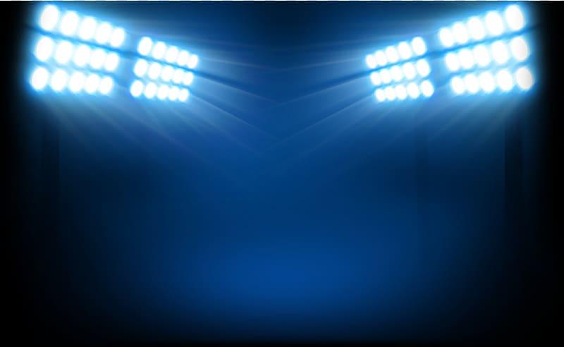Four blue spotlight towers, Lighting Soccer.