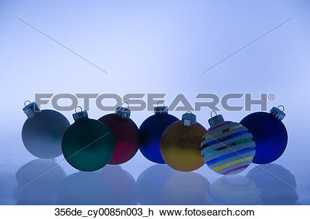 Stock Photo of Multiple colorful Christmas tree bulb ornaments on.