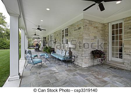Stock Photography of Bluestone patio with columns and blue.