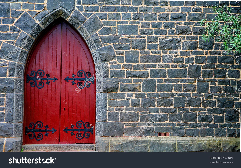 Red Wooden Door In Bluestone Church Stock Photo 77563849.
