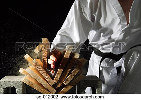 Stock Photo of Blackbelt Breaking a Stack of Boards sc.