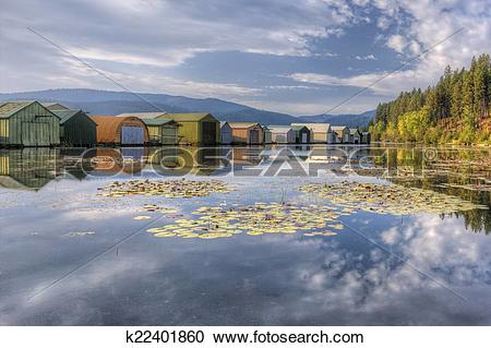 Stock Photography of Boat garages on calm lake. k22401860.