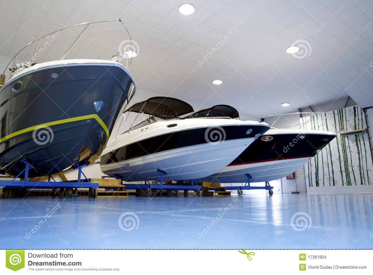 Pleasure Boats In Garage Stock Images.