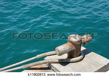 Stock Photo of Iron pole for tie the boat with har k11802813.