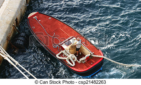 Stock Image of Launch motorboat with ropes of tie.