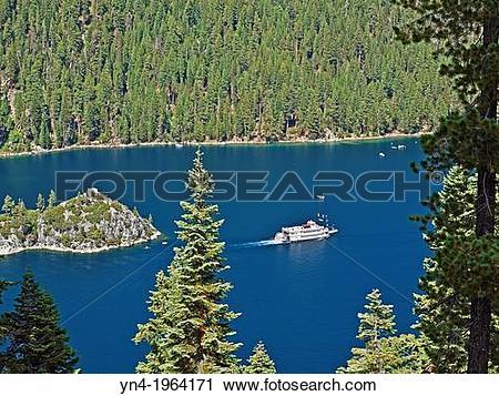 Stock Photography of A tourist paddlewheeler cruises around.