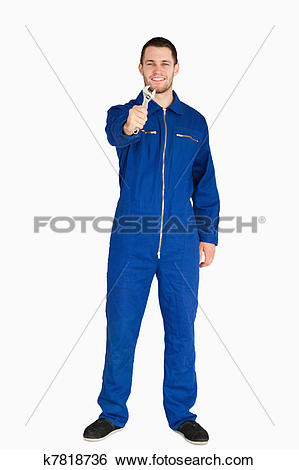 Stock Images of Smiling young mechanic in boiler suit showing his.