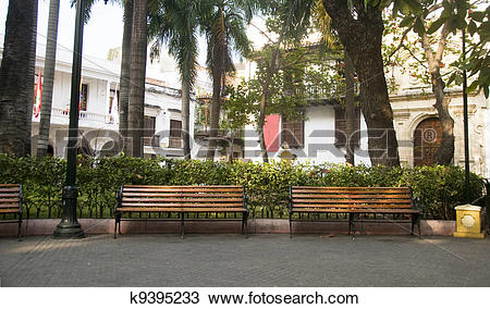 Stock Photo of Bolivar Park benches trees by Museum of History.