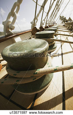 Picture of Ropes tied up with bollards in a boat u13571597.