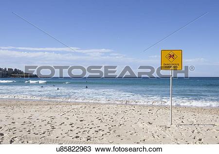 "Stock Photo of ""Dangerous Current"" sign on Bondi beach, Sydney."