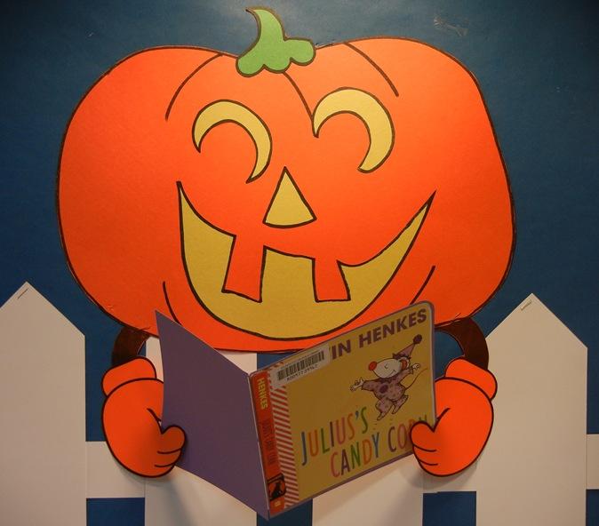 5 reading pumpkins.