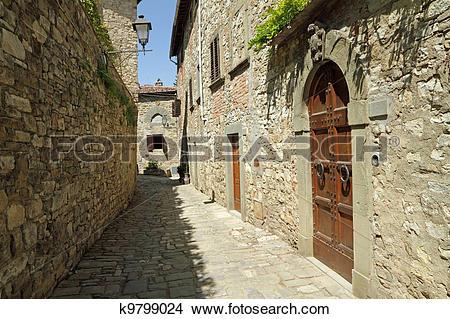 Stock Photo of narrow stone street in tuscan borgo Montefioralle.
