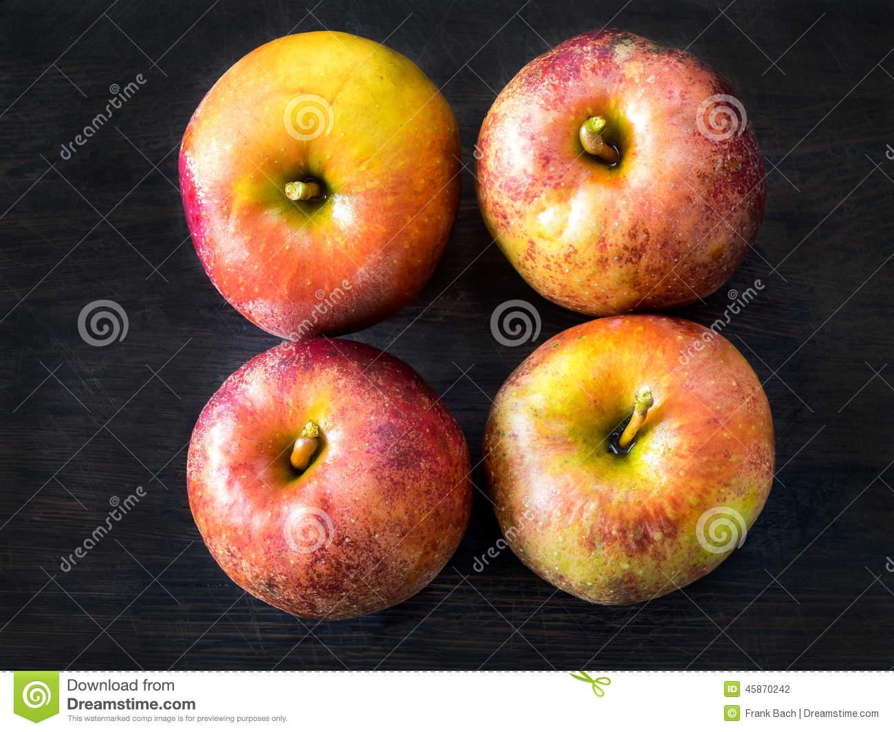 Four Red Apples, Belle De Boskoop Stock Photo.