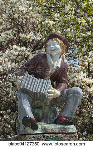 Stock Photography of Statue of a boy with an accordion.