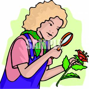 Botanist Looking At a Flower Through a Magnifying Glass.
