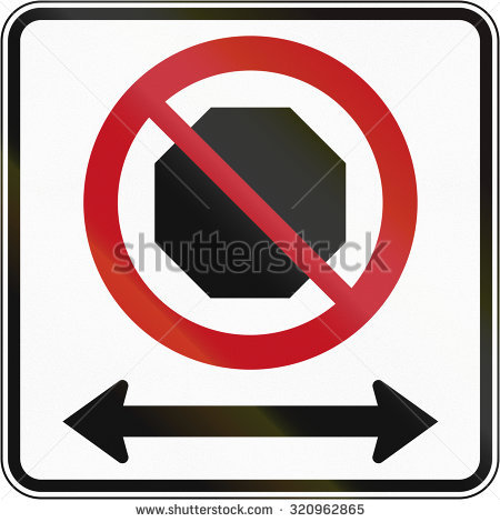 Canadian Road Sign: No Stopping In Both Directions. This Sign Is.