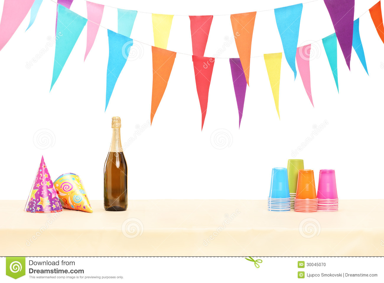 Bottle Of Sparkling Wine, Plastic Glasses And Party Hats Stock.