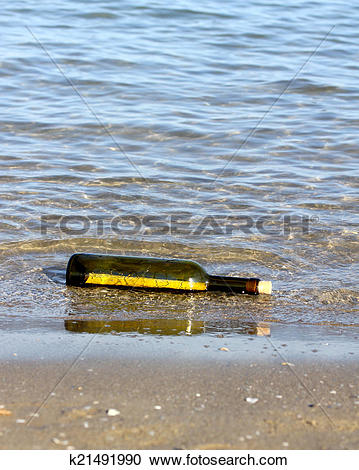 Stock Photography of treasure map in the bottle on the shore of.
