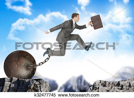 Stock Image of Businessman hopping over bottomless pit k32477745.