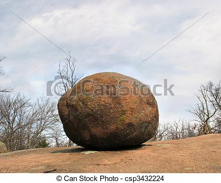 Stock Photo of Pink Granite Boulder on top of hill.