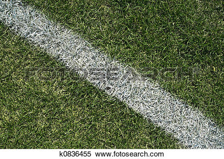 Stock Image of White boundary line of a playing field k0836455.