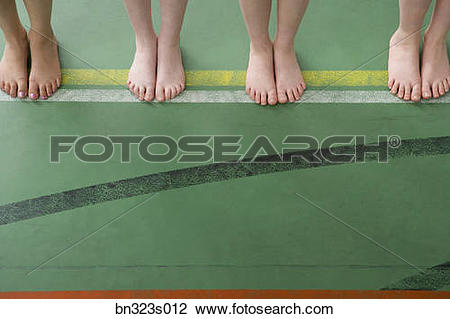 Stock Photo of Bare feet standing on boundary line bn323s012.