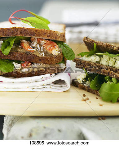 Stock Image of Dark bread with boursin cheese and rocket,crab and.