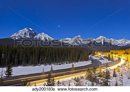 Stock Images of A moonlit nightscape over the Bow River and.