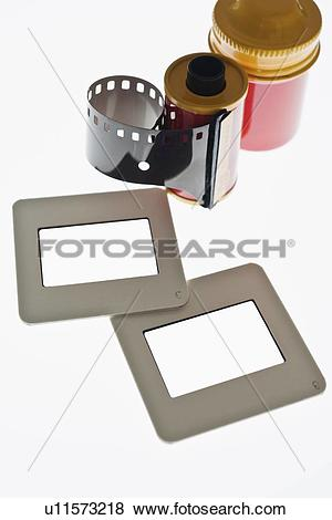 Pictures of Close up of camera film and slide frames on light box.