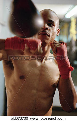 Stock Photography of Boxer hitting speed bag bld073700.