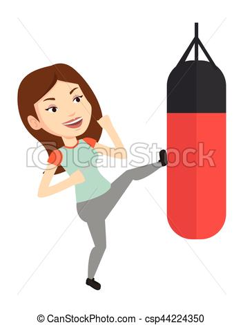 Woman exercising with punching bag..