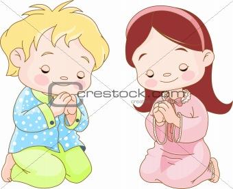 Image 3900823: Children praying from Crestock Stock Photos.