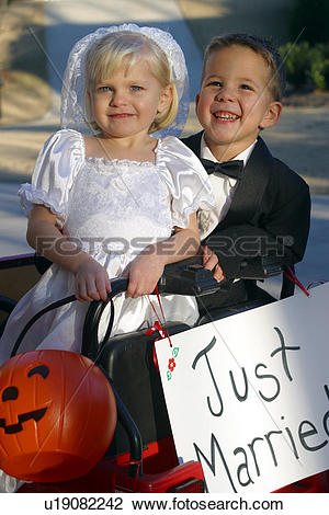 Stock Photo of Little Boy And Girl Trick.