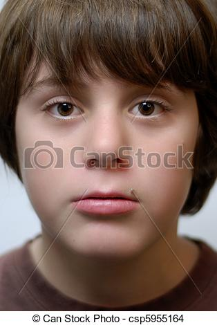 Stock Photo of twelve year old boy with big brown eyes csp5955164.