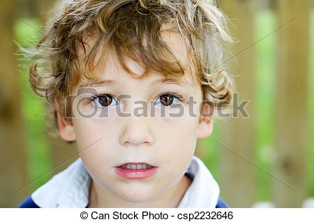 Stock Image of boy with big brown eyes.
