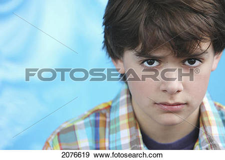 Stock Photograph of Portrait of boy with brown hair and brown eyes.