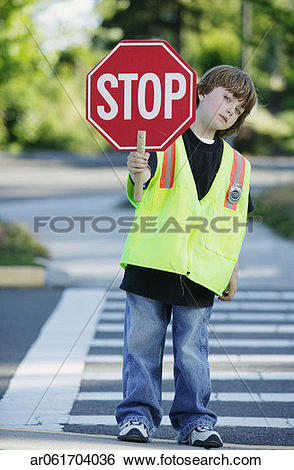Stock Images of Portrait of a young boy crossing guard standing on.