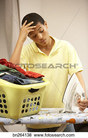 Pictures of Teenage boy ironing bn264138.