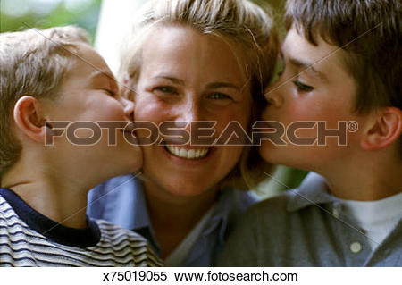Stock Image of TWO BOYS KISSING MOM ON HER CHEEKS x75019055.