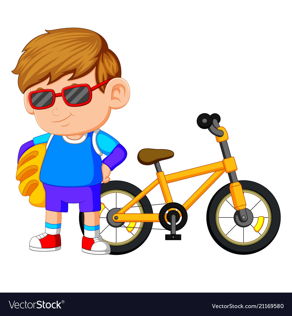 A boy standing on the bike.