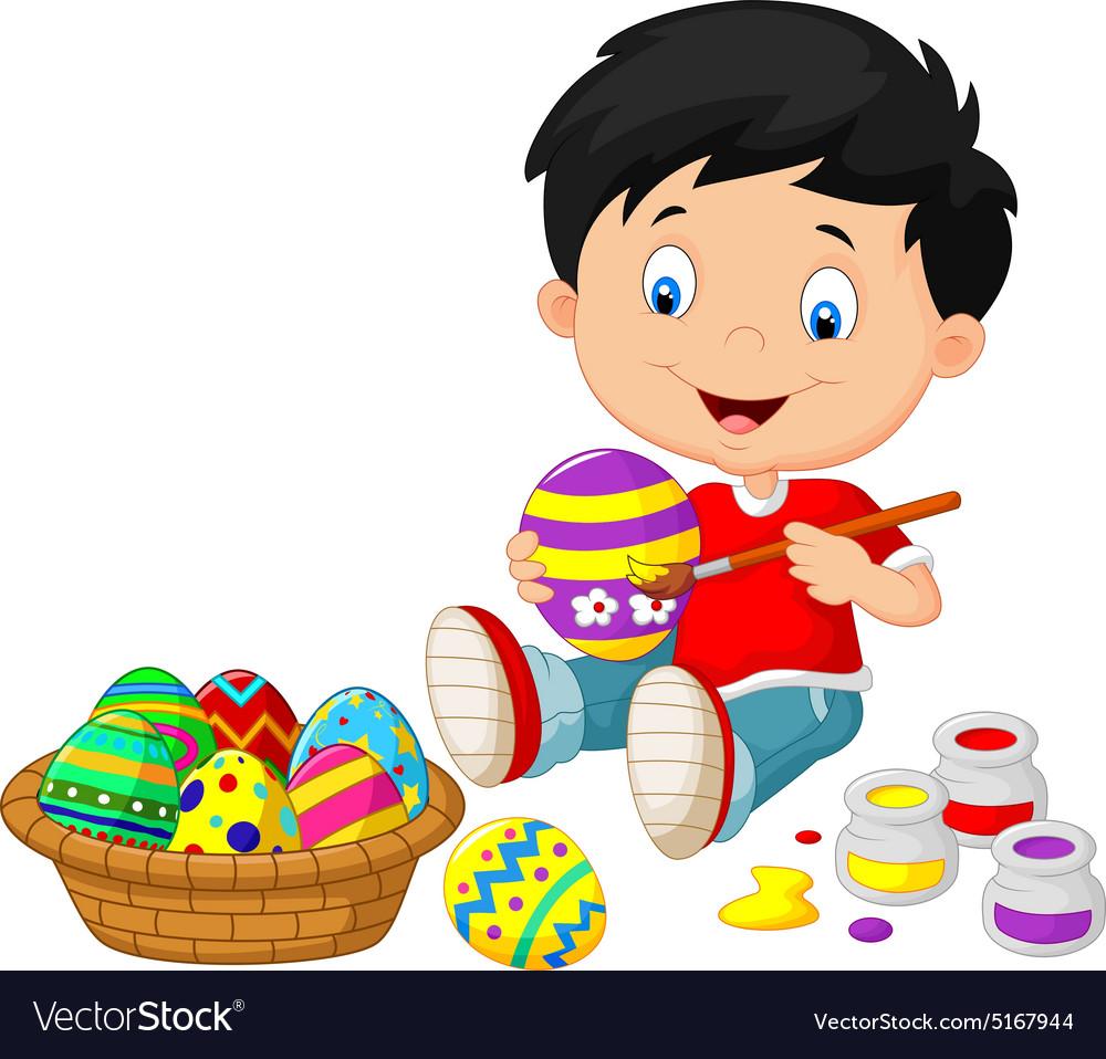 Little boy painting an Easter egg.