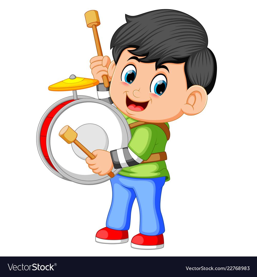 A boy playing big drums.