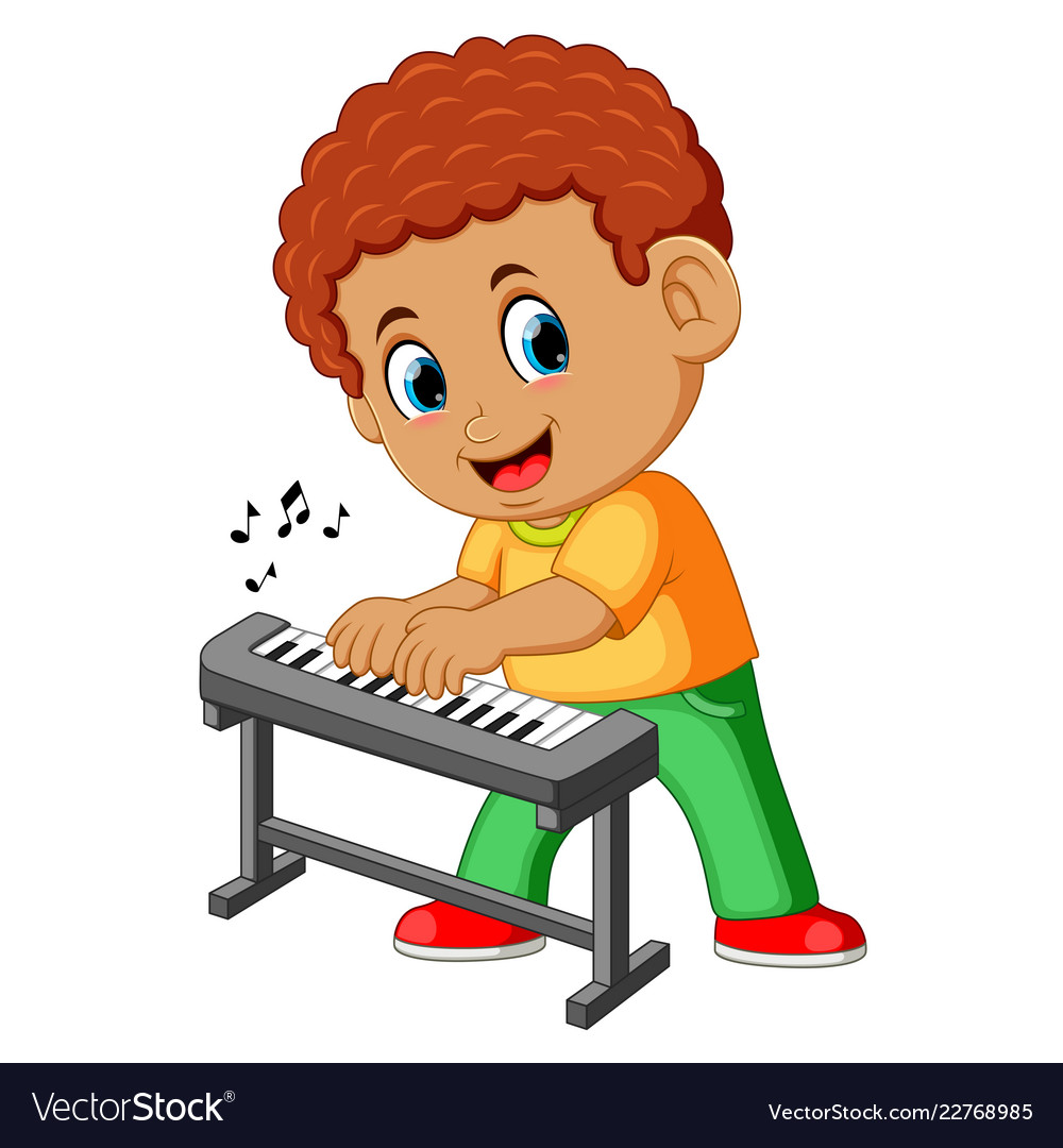 Happy little boy playing piano.