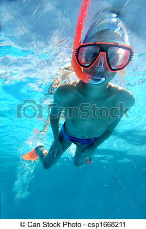 Stock Photography of Swimmer swimming underwater.