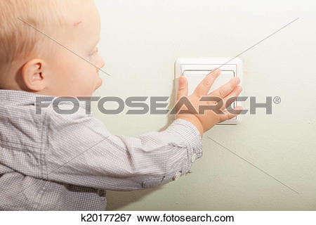 Picture of Baby boy child kid turning on the light. k20177267.