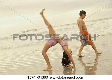 Stock Photography of Side profile of a girl bending over backwards.