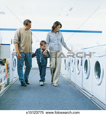 Stock Image of Boy Holding Hands With His Mother and Father.